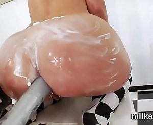 Kinky lezzies fill up their thick arses with milk and squirt it out