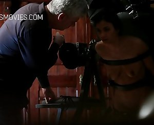 Slut trussed with leather straps and grimaced with a riding crop